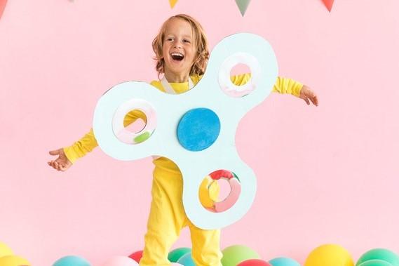 boy in fidget spinner costume