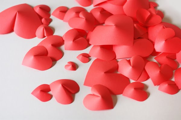 pile of 3D paper hearts