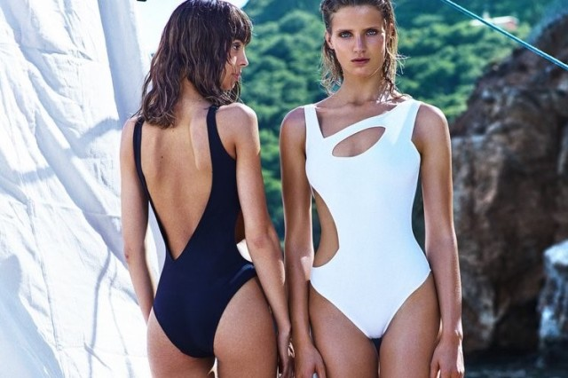 two women in asymmetrical swimsuits