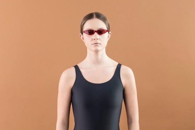 woman in black swimsuit with glasses