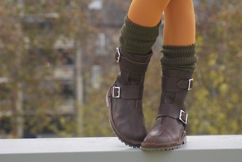 girl in boots on wall