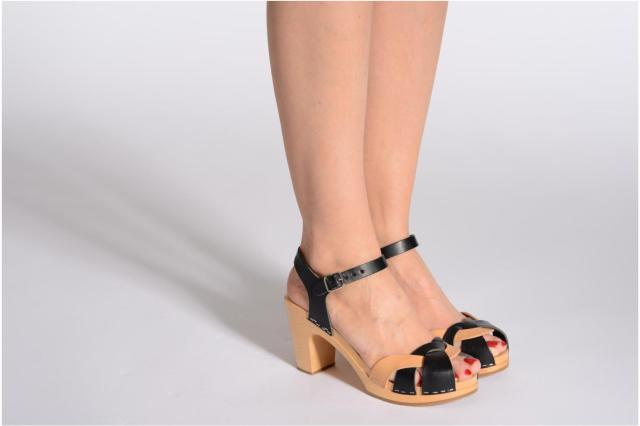 woman in black and tan sandals