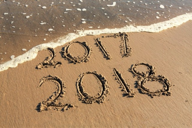 2017 and 2018 written in the sand
