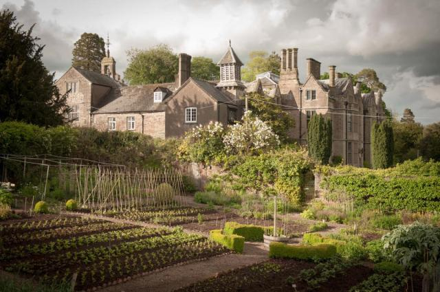 walled garden with stately home in background