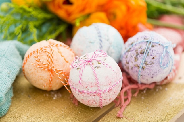 colourful bath bombs tied with string.