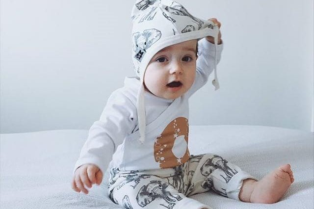 Baby in Romper with Hat