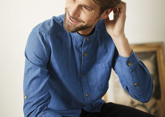 Blue shirt worn by bearded man