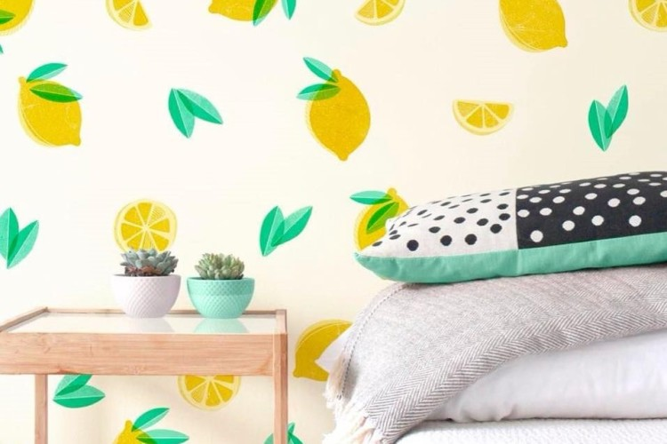 lemon stickers on pale wall