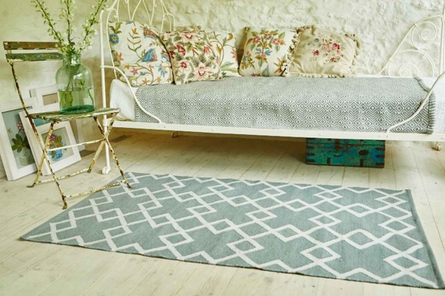 day bench with rug on timber floor