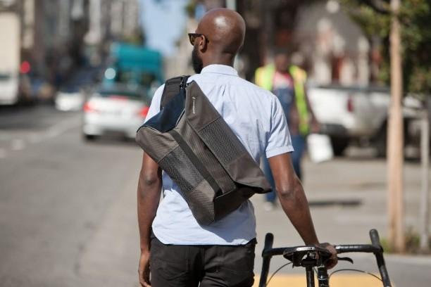 man wearing cross body bag