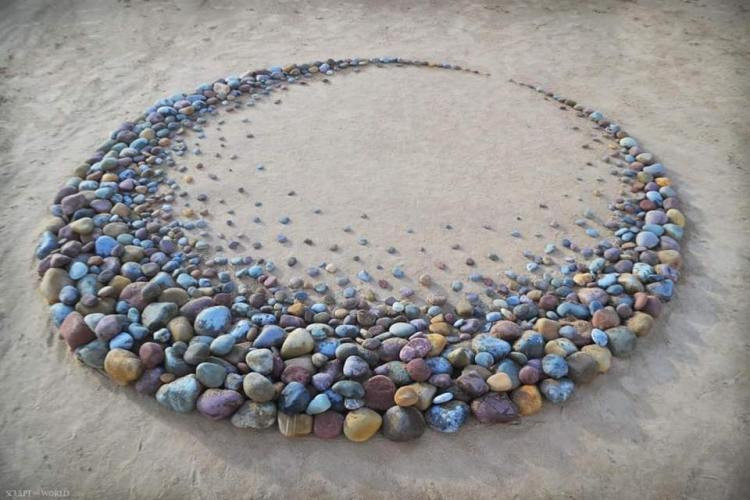 Circle of stones on sandy beach